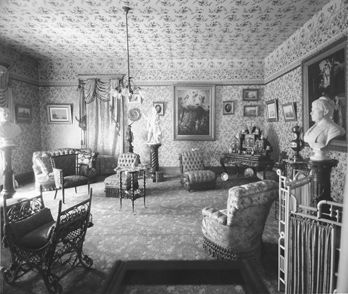 The interior of a home from what appears to be the Victorian age